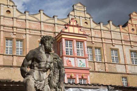stoop: Weathered men statue in front of the castle of Bernburg Saxony-Anhalt