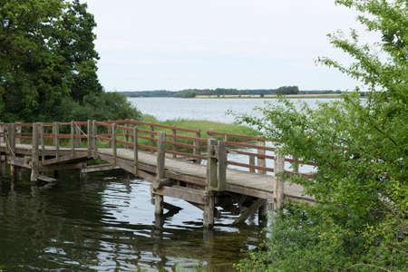 drawbridge: Wooden drawbridge over a canal in Nykobing Denmark
