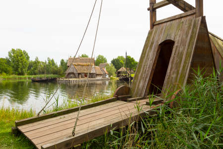 middle ages boat: Mobile drawbridge with archway and wooden walkway inside Stock Photo