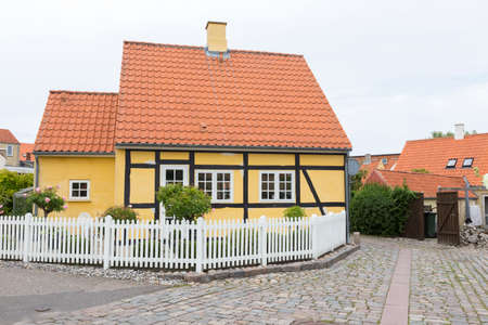 garden settlement: Yellow half-timbered house in a side street in downtown Nykobing