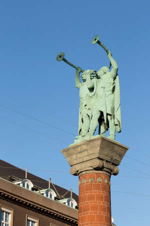 verdigris: Statue of two Luren players on a high column at Copenhagen Town Hall