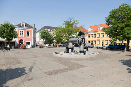 central square: Modern fountain sculpture in the central square in Nykobing Denmark