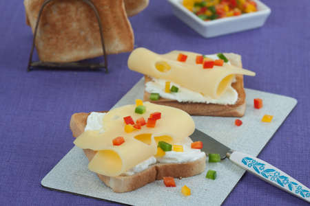 edam: Slices of toast with edam Ksescheiben garnished with three kinds of pepper