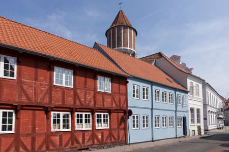 row of houses: Different colored row houses in the small town of Nakskov Lolland Denmark Stock Photo