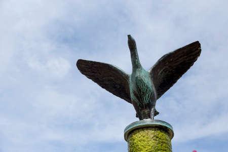 verdigris: Steel Goose on top of a fountain Stock Photo