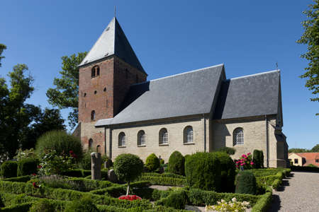 totaled: Church and cemetery in the village Skelby Falster Denmark