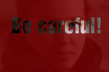 careful: Girls face in  a red  with the inscription BE CAREFUL