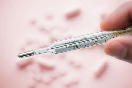 Close view of mercury thermometer which showing 38C