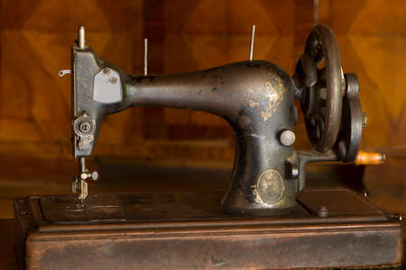 black and white sewing: Close view of an antique sewing machine.