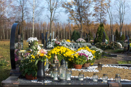 cemetry: Close view of cemetry with flowers and candles in autumn