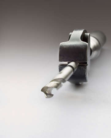 broach: Close view of a borer in a jeweler clamp Stock Photo