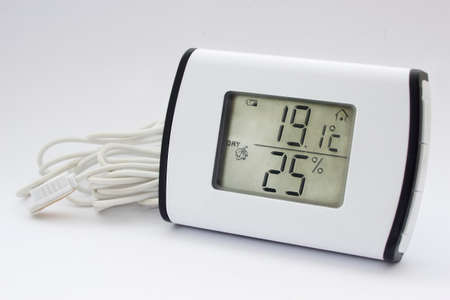 thermo: Close view of electronic thermometer hygrometer in a white background Stock Photo