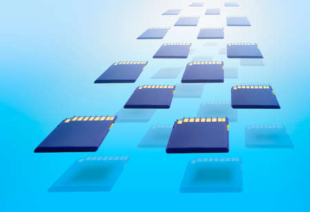 teck: Blue memory cards in blue gradient background Stock Photo