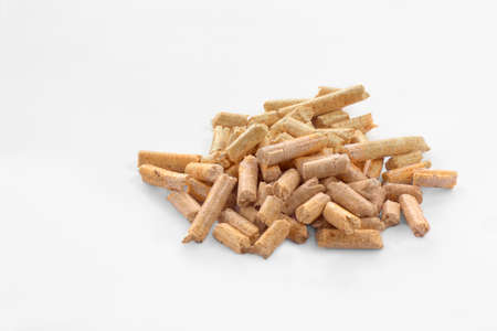 wood pellets: Wood pellets in a white background Stock Photo