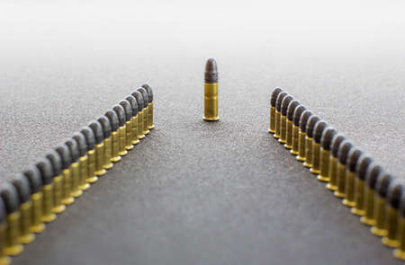 reloading: Two rows  of cartridges. An order and a chief. Stock Photo