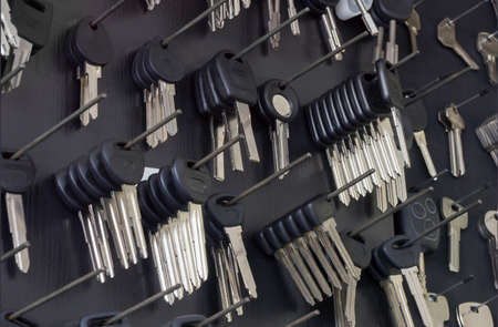 duplicate: Keys for cutting on a special wall in a workshop Stock Photo