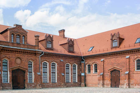 eponymous: Raudondvaris Castle (Lithuanian: Raudondvario pilis, literally Red Manor), also referred to as Raudondvaris Manor, is a Gothic-Renaissance gentry residence, located in the eponymous town of Raudondvaris, Lithuania. In a photo manor stables Editorial