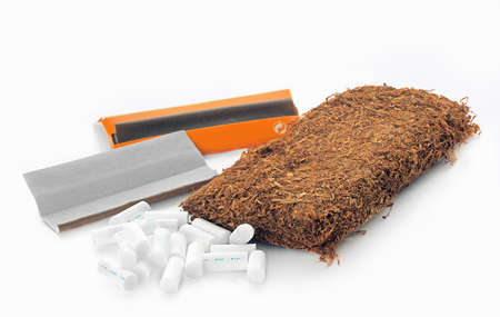 rolling paper: Tobacco  and cigarettes rolling paper and filters on a white background