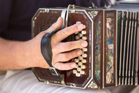aerophone: Man playing the bandoneon, traditional tango instrument, Argentina. Close view. Stock Photo