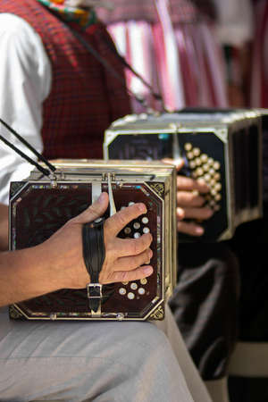 aerophone: Mans playing the bandoneon, traditional tango instrument, Argentina. Close view. Stock Photo