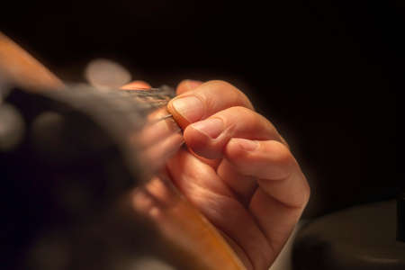 fingerboard: Close view of mans hand on a violin fingerboard Stock Photo