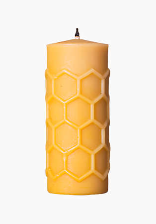beeswax candle: Close view of a beeswax candle isolated on a white background