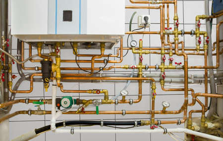 Close view of copper pipes engineering in boiler-room 免版税图像