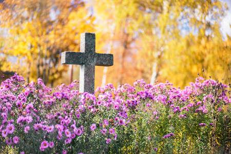 graves: Concrete cross in cemetery in autumn Stock Photo