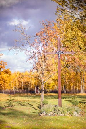 Wooden cross in autumn background