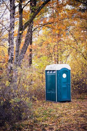 latrine: Portable toilet at an outdoor in autumn Stock Photo