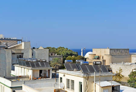 gelio: Solar water heating systems on the houses roofs in Rhodes Island