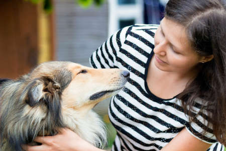 endear: Portrait of smiling girl with collie Stock Photo