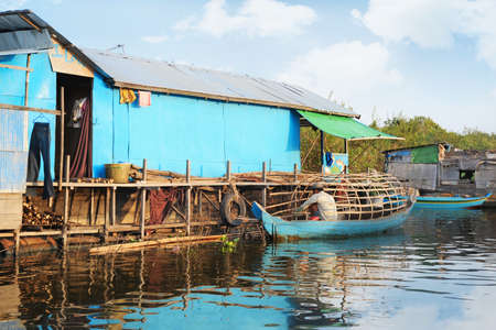 house float on water: Poor life on a water in Cambodia Stock Photo