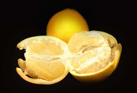 freshest: Two pomelo fruits  on a black background