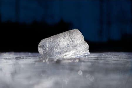 melting ice: Melting ice piece on a  dark background