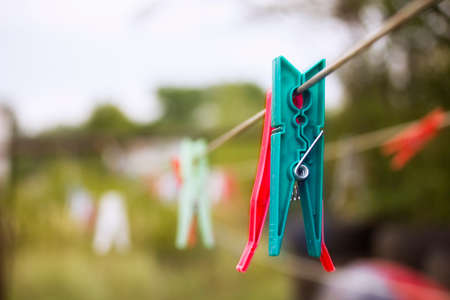 clothespin: Plastic clothespin hanging on a rope, depth of field Stock Photo