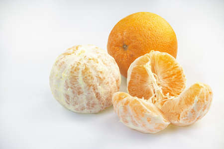 cantle: Three orange fruits on a white background