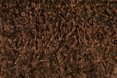 compressed: Dark compressed woodchip sheet background or texture.
