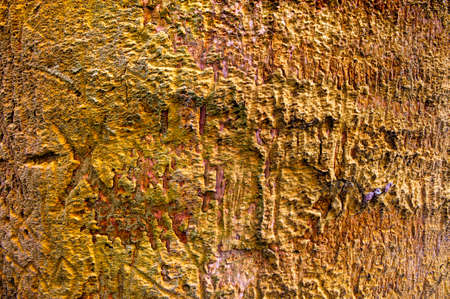 Weathered old insulation foam on an a outdoor wall for background