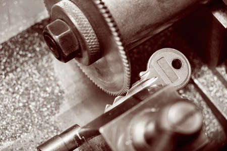 Close view of key copying machine with key. Stok Fotoğraf