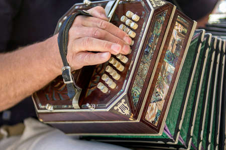 bandoneon: Man playing the bandoneon, traditional tango instrument, Argentina. Close view. Stock Photo