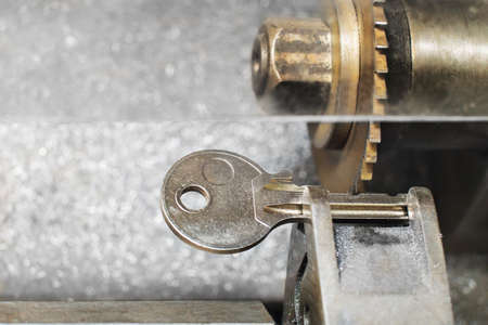 Close view of key copying machine with key. Stock Photo