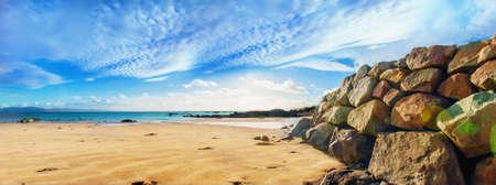 Panoramic landscape with big seashore stones and sand. ireland.