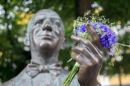 Blue flowers in a  sculpture hand of Danielius Dolskis ,popular Lithuanian singer noted in pre-revolutionary Russia and in inter-war Lithuania.