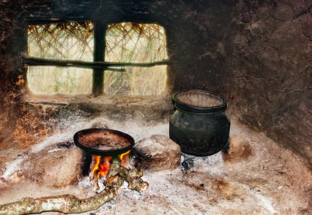 Sri Lankas poor peoples kitchen in the hut. A frying pan and a pot on a primitive cooker