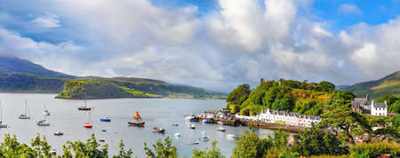 Panoramic landscape with boats , yachts and sailboats in Portree harbour Isle of Skye Highlands and Islands, Scotland