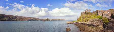 Panoramic view from Crookhaven (Irish: An Cruachán), a village in County Cork, Ireland, on the most southwestern tip of the island of Ireland.  Stock Photo