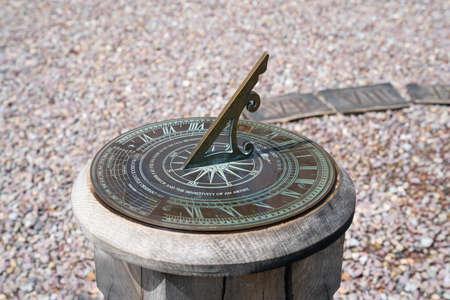 Sundial on a wooden pedestal. Close up. 스톡 콘텐츠