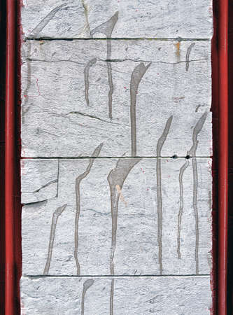 Concrete slabs with red pipes at the edges. Close view. Background and texture.