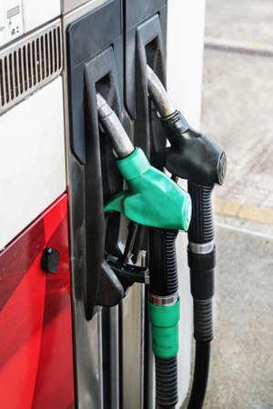 Green and black petrol guns. Close up. Stock Photo